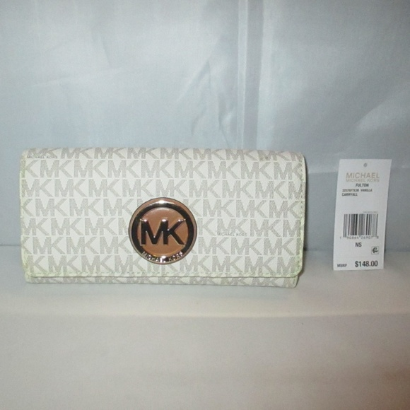 6ddd78d248c6c4 Michael Kors Fulton MK Logo Carryall Flap Wallet. M_5bfdb7889539f7617b3b57dd